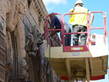 Applying Cocoon to remove damp and associated salts which caused stone to fall off the building.