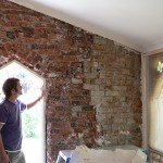 Removal of render clearly shows poor repair methods used thirty years ago.