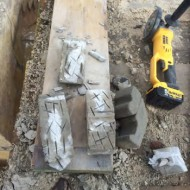 Figure 38_Replacement corbels:  Once set they are released and scratched for key with an angle grinder.