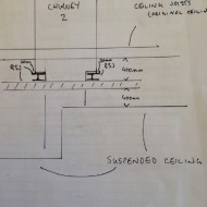 Figure 9_Stack 2 builder's sketches of the position of earlier RSJ's inserted during remodelling works which removed the wall below. Note: the stacks flue cranks therefore the tie down post tensioned detail was unable to directly tie the stack down to the RSJ's. With engineer's approval the stack was stiffened at the roof plane and additional helifix ties link the reinforced stack back to the masonry supported on RSJ's.